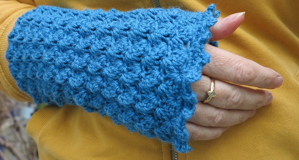 teal bobble wrist warmers